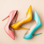 Three different colored high heeled shoes