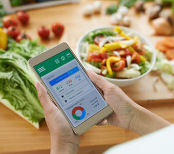 Person using smart phone app to track food and look at nutritional values