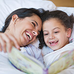 Bedtime routine mother and daughter reading book