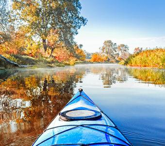 Kayak on river during fall