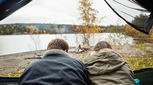Couple Camping Next to Lake in Fall
