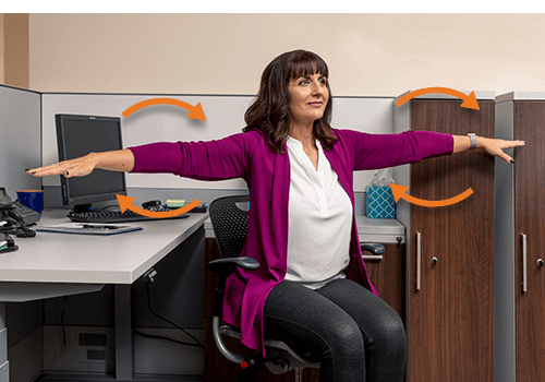 Woman performing Desk Exercise Arm Circles