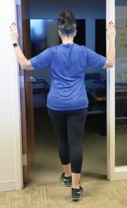 Woman stretching with Pectoral stretch