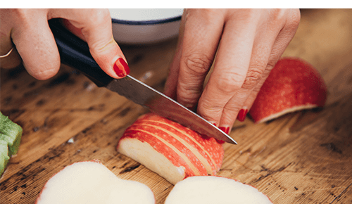 Buy Foods Whole Woman Cutting Apples