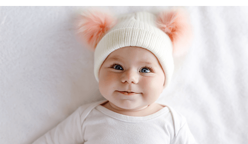 Baby with hat on looking at camera