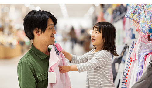 Father and Daughter Shopping for Clothing