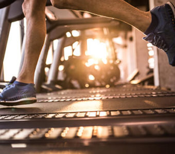 Closeup of a runners on a treadmill in a gym