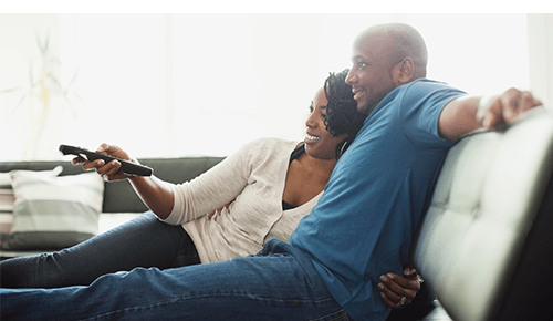 Adult Couple Relaxing Watching TV on Couch