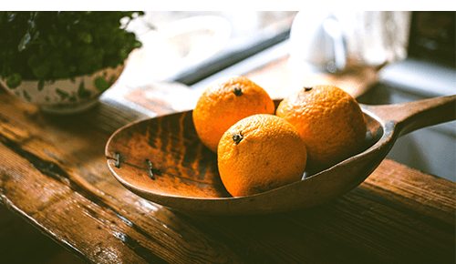 Decorate bowl of oranges on table