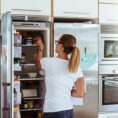 Person organizing refrigerator