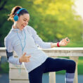 Person dancing to music as they workout outside