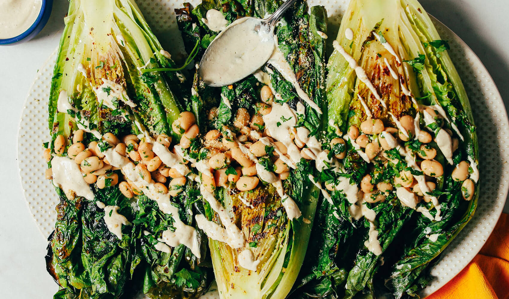 Grilled Romaine Caesar Salad with Herbed White Beans