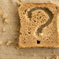 Piece of bread with a question mark cut out of it