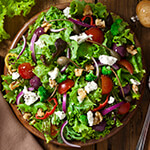 Bowl of salad with vegetable toppings