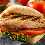 Grilled chicken salad topped with lettuce and tomato