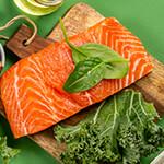Raw salmon filet on cutting board