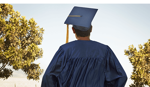 Teenager in graduation robe and cap