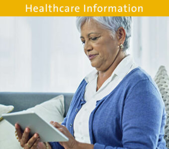 Woman using tablet to make doctor's appointment