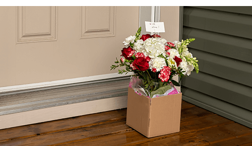 Box of flowers delivered to front door