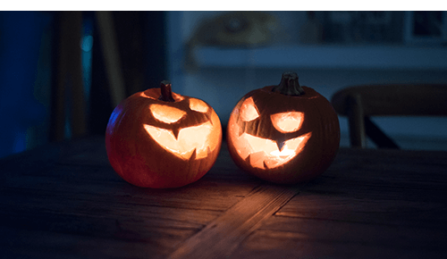 Two lit up Halloween jack-'o-lanterns