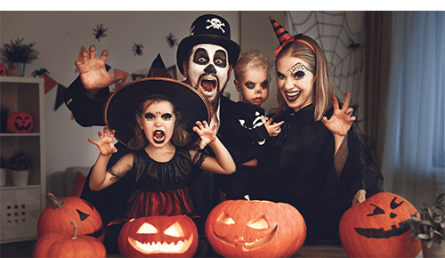 Family dressed in costumes and making scary faces