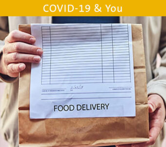 Person holding food delivery bag