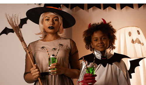 Mother and child wearing Halloween costumes