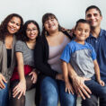 Hispanic family smiling at camera in group photo