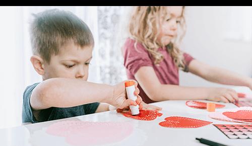 Children doing valentine's day arts and crafts