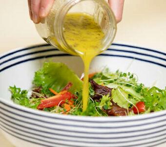 Lemon Miso dressing poured onto a salad