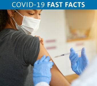 Person receiving vaccine shot