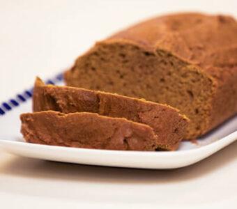 Pumpkin bread loaf sitting on plate